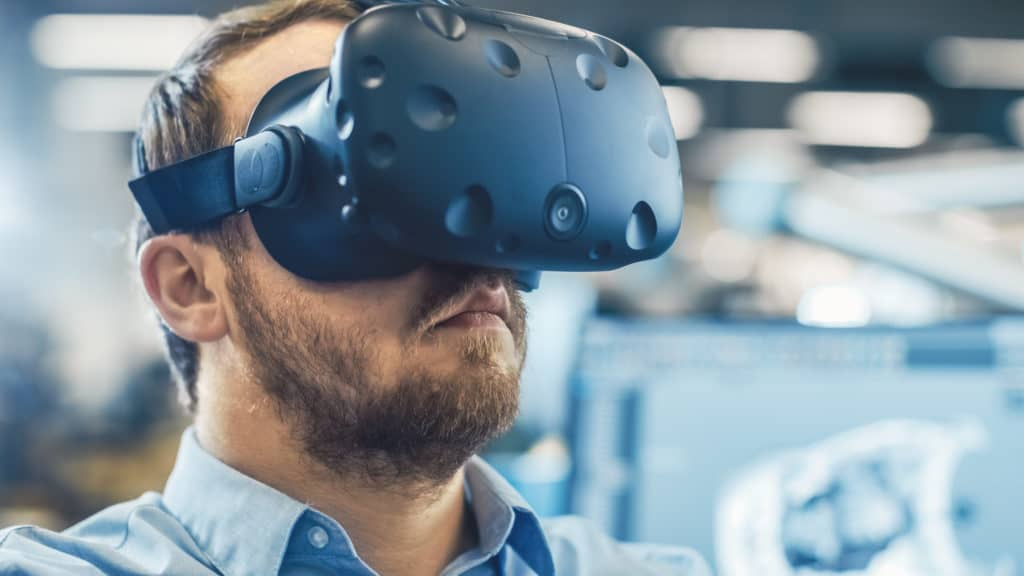Man learning in VR. VR helps with training effectiveness