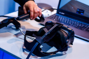 Headset in front of a computer when designing a VR training scenario