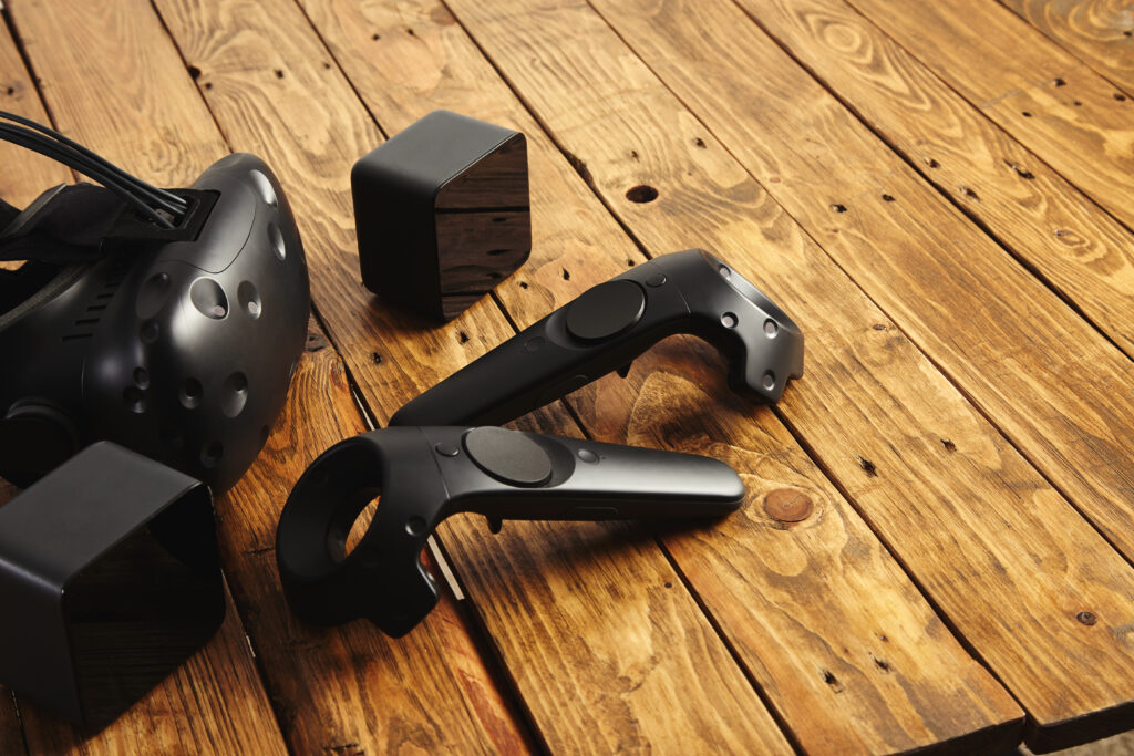 Photo of VR headset and controllers on table.