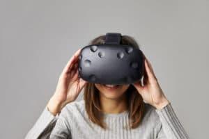 Woman wearing headset, comparing 360 video vs. virtual reality